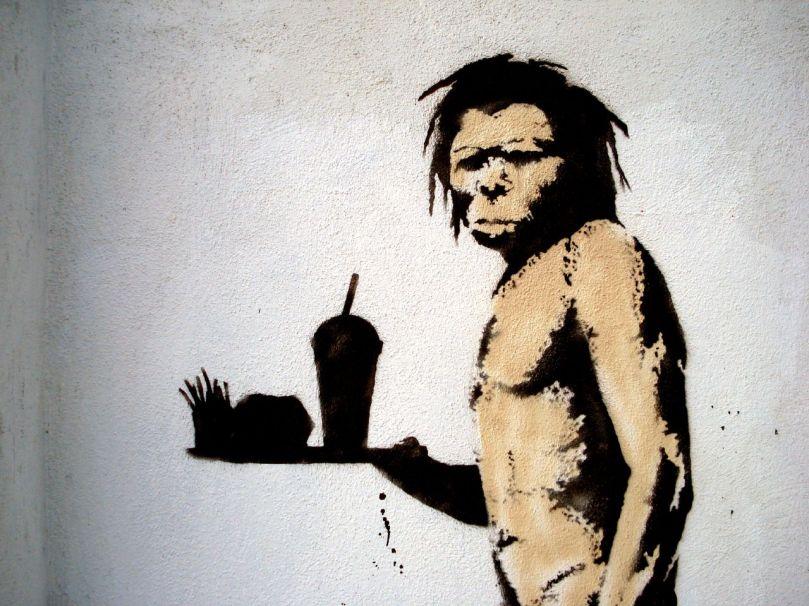 caveman-eating-fast-food